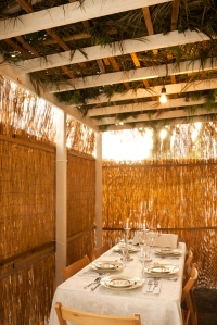 Inside of a Sukkah (hut) with a table set for Sukkot