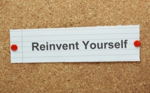 The phrase Reinvent Yourself on a cork notice board